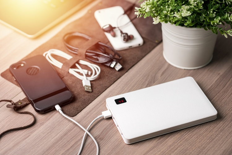 Charging the empty battery smartphone with white power bank.